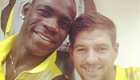 Photo: Mario Balotelli celebrates Liverpool win with Steven Gerrard