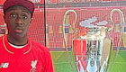 Dutch wonderkid poses with Liverpool silverware
