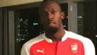 Watch Man Utd fan Usain Bolt pay up forfeit after Arsenal bet