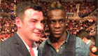 Photo: Liverpool striker Mario Balotelli meets boxer Joe Calzaghe