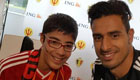 Chadli poses with young Red Devil