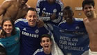 Chelsea players celebrate Liverpool victory
