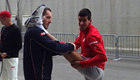 Photo: Novak Djokovic demonstrates his flexibility with morning stretch