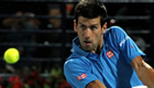 Djokovic survives Federer surge to win 50th title