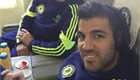 Fabregas listens to his tunes with Azpilicueta