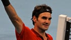 Photos: Federer secures 100th career win
