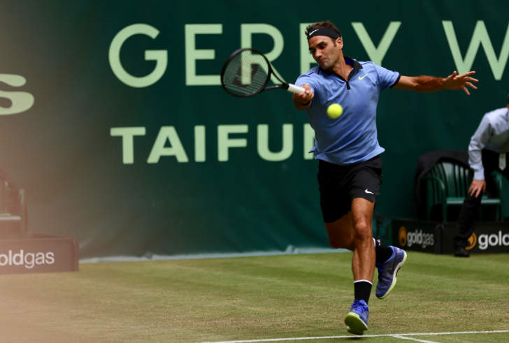 Federer claims 1100th tour win in Halle