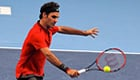 Federer survives 33 Karlovic aces to set up Goffin final
