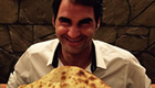 Federer enjoys giant naan bread in India