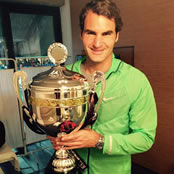 Federer all smiles after first clay title since 2012