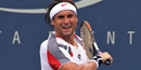 Ferrer tops Hewitt in battle of over-30 warriors