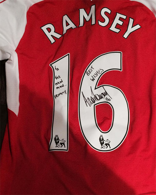 6c3aade51 Photo  Aaron Ramsey sends signed shirt to former Arsenal star