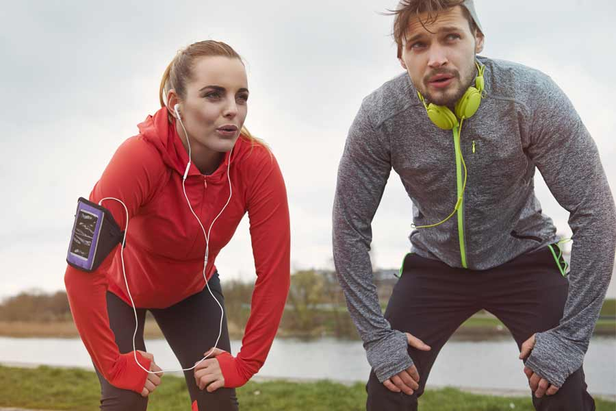 Man and Woman Running Rest