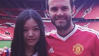 Photo: Juan Mata all smiles with Man Utd fan in new Adidas kit