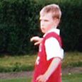 Picture: Mertesacker poses in Arsenal shirt as a boy