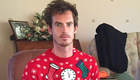 Photo: Andy Murray less pleased with Christmas jumper than Arsenal shirt
