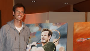 Andy Murray and Petra Kvitova pose with portraits ahead of Madrid Open
