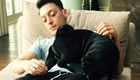Photo: Arsenal star Mesut Ozil puts his feet up with his dog