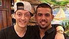 Photo: Arsenal star Mesut Ozil salutes Turkish starlet Baris Sarikaya