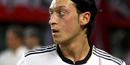 Mesut Ozil injury: Concern for Arsenal as Germany star limps off