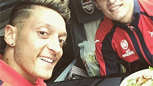 Photo: New Arsenal signing all smiles with Mesut Ozil after 3-1 win at Watford