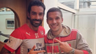 Photo: Lukas Podolski poses with Arsenal legend Robert Pires