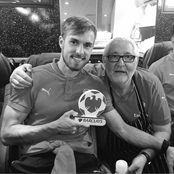Ramsey poses with man of the match award