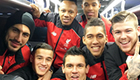 Liverpool players celebrate on team bus