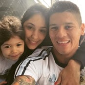 Rojo poses with his young family for selfie