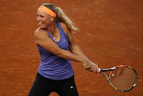 Kvitova wins first match at French Open after knife attack