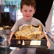 Rooney hands golden boot to his son