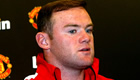 Rooney plays down title talk after Villa draw