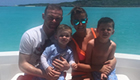 Photo: Man Utd's Wayne Rooney all smiles on holiday with wife and kids