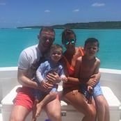 Rooney all smiles on holiday with wife and kids