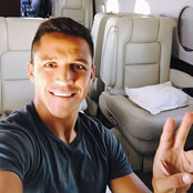 Sanchez all smiles in private jet
