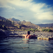 Smalling relaxes in hot springs in Peru