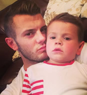 Photo: Arsenal's Jack Wilshere chills out with his son Archie