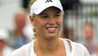 US Open 2014: Caroline Wozniacki progresses despite bad hair day