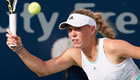 Wozniacki out as Sharapova progresses